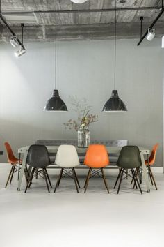 Industrial dining room with orange accents