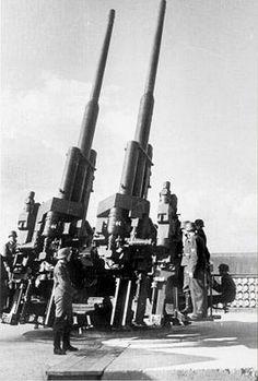 "One of four 12.8 cm 'Flak 40' anti-aircraft twin guns on the Berlin-Humboldshain  ""flaktower""."