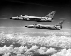 A pair of F11F-1 Tigers assigned to Fighter Squadron (VF) 211 pictured in flight in 1959.