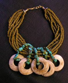 Necklace |  Anne Holland.  Five donut hole pendants swing from turquoise and Indonesian  glass beads. Pendants are yak bone or they might be old shell. | SOLD