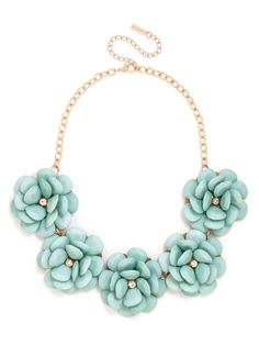 Made from faceted gem petals with a clear crystal center, this oversized bloom necklace has flower power in spades.