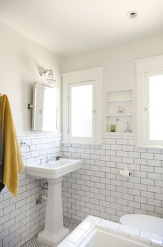 Vintage Modern Bathroom subway tile wainscot transition | design: bath | pinterest