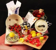 A whole blog devoted to dollhouse miniature food!? And how neat is the 'making strawberry jam' set?