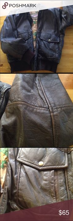 B52 leather bomber jacket Real leather, light wear. Heavily lined inside, extremely warm in cold weather. Hidden inside pocket. Needs conditioning soon. I would keep it but won't be able to get down to this size any time soon...please give it a good home. Cat friendly home but in spare room closet. Wood background is dining table, not the floor. B52 Jackets & Coats