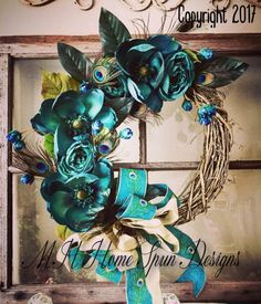 Peacock and floral grapevine wreath