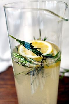 A Rosemary Gin Fizz    Recipe:  1 cup rosemary simple syrup (Boil one cup of sugar in one cup of water with a couple rosemary sprigs thrown in. Boil until the sugar is dissolved. Let cool.)  1 cup gin  1/4 cup fresh lemon juice   1 bottle of Prosecco (or 2, if you want the cocktail to be lighter)    Stir ingredients together in a punch bowl or carafe, and garnish with sprigs of rosemary.