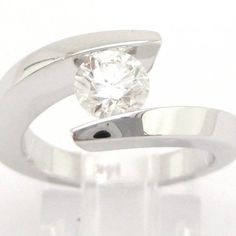 Round diamond engagement ring tension set 0.75ctw
