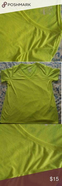 Never worn! Neon yellow Nike t-shirt Had been washed, but never worn. Excellent to perfect condition. Thin, Dri-fit tee. V-neck. Nike Tops Tees - Short Sleeve