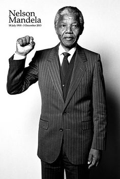 Celebrity Maxi Poster: Remember the life of one of the greatest political figures and social activists to have ever lived with his magnificent black and white Nelson Mandela maxi poster. Pictured in a pinstripe suit, South Africa's first black president holds his fist in the air in a salute which is reminiscent of the sign he made when he was released from Victor Verster Prison in 1989.