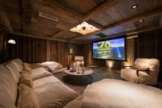 Home Theater in a Chalet- love the inset chandelier! home theater cinema room interior design Home Cinema Room, Home Theater Setup, Home Theater Rooms, Home Theater Seating, Home Theater Design, Cinema Theater, Movie Theater, Deco Design, Design Case