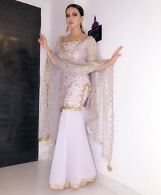 The Stylish And Elegant Gharara In Pastel Violet Colour Looks Stunning And Gorgeous With Trendy And Fashionable Georgette Fabric Looks Extremely Attractive And Can Add Charm To Any Occasion. Indian Wedding Outfits, Bridal Outfits, Indian Outfits, Eid Outfits, Pakistani Dress Design, Pakistani Outfits, Dress Indian Style, Indian Dresses, Indian Designer Outfits