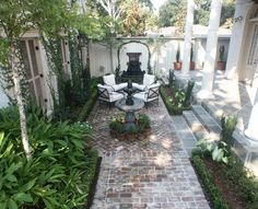 I like how the boxwoods and the pavers are done. The distressed brick.