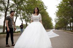 Iraqi people take photos with the Iranian model Chunur Muhammed as she displays the custom made 200 meter long wedding dress at Sami Abdulrahman Park in Erbil...