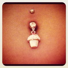 A girl can never have too many dangly belly button rings...and cupcakes. :)