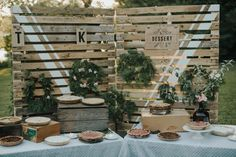 This Ontario summer camp wedding features DIY outdoors-inspired décor, a handmade bridal gown, and a fun kazoo processional entrance.
