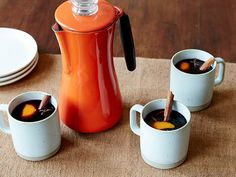 Alton's Mulled Wine : Brewed in a coffee percolator, Alton's mulled wine is deeply spiced and aromatic. He adds allspice berries, black peppercorns, star anise and cinnamon sticks to this honey-sweetened sipper.