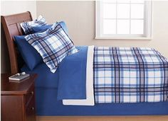 Blue & White Plaid Queen Comforter Set (8 Piece Bed In A Bag) by Country Living. $63.94. The comforter and shams feature a solid pattern on one side and a blue and white checkered print on the other side that gives it a trendy appeal. This machine washable comforter set contains comforter, flat sheet, fitted sheet, pillow case(s), sham(s), and bed skirt. Freshen up the look of your bedroom with this Blue & White Plaid Bed in a Bag Bedding Set. This machine washable comforter...