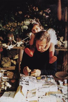 Peter Beard working on his diaries with his daugher Zara Photography by Alexandre Bailhach