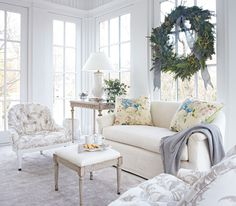 An all white room looks simply ethereal; light blue accents add a wintry touch. - Traditional Home® / Photo: Werner Straube / Design: Frank Babb Randolph