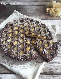 Crostata al cacao con crema pasticcera un dolce che non delude mai golosa pasta frolla al cacao farcita con una deliziosa crema pasticcera.