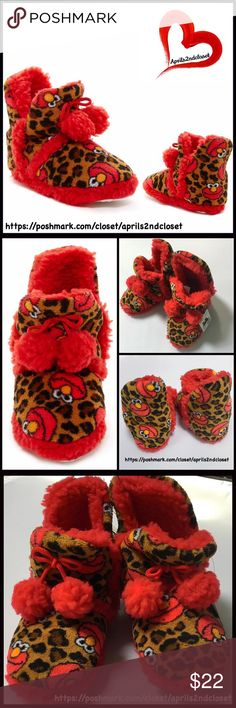 Elmo Slippers By SESAME ST. 💟NEW WITH TAGS💟  Elmo Slippers By SESAME ST.   * Round toe  * Allover print  * Slip-on style  * Cozy faux-shearling like lining  * Pompom detail  * Textured, slip resistant soles  * True to size, tagged size 13/1  * Machine wash Material: Polyester Color: Red Como Item#SSA291  🚫No Trades🚫 ✅ Offers Considered*✅ *Please use the blue 'offer' button to submit an offer Sesame Street Shoes Slippers