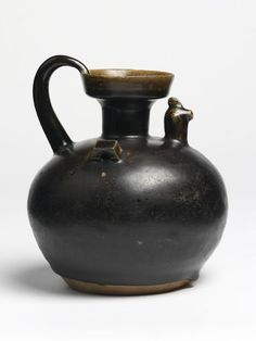 Although not hailed as a 'classic' ware by ceramic connoisseurs, 'blackware' from Deqing, where this ewer was made, represents an important milestone in the history of Chinese ceramics, for it was from this early southern stoneware that the famous dark-glazed tea bowls of the Song dynasty evolved. Date: 317-420 (made) Place: Zhejiang