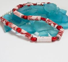 For Sale at Etsy: Check Etsy for more pictures! ♥I hand rolled these beautiful red and white beads from recycled scrap book paper gave them three generous coats of gloss make the color pop an...