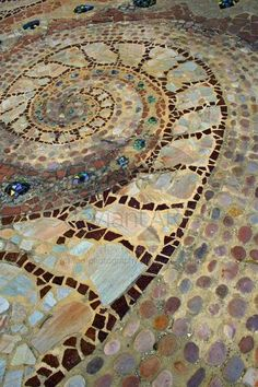 Natural floors with cobble stones and smashed tile.