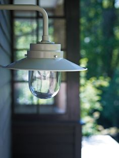 Outdoor Light - Inspired by a wartime naval design, a fine looking light for outdoor walls, patios and garages. In a neutral putty colour and zinc plated steel for durability. £90.00