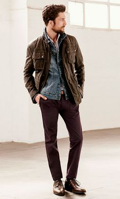 Shop this look on Lookastic: https://lookastic.com/men/looks/field-jacket-denim-jacket-long-sleeve-shirt-chinos-derby-shoes-belt/3999 — White Long Sleeve Shirt — Blue Denim Jacket — Dark Brown Field Jacket — Tan Leather Belt — Burgundy Chinos — Dark Brown Leather Derby Shoes