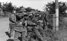 Leibstandarte personnel firing their Kar 98 bolt-action rifles and a captured SVT-40 during Operation Barbarossa in 1941