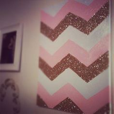 Newest addition to my bedroom wall! Made a stencil of a chevron zig-zag, traced, and painted. I left a few stripes blank to add gold glitter...