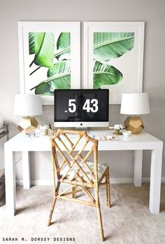 This green and white banana leaf print is perfect in this sleek home office. Love the beachy coastal chair with the white desk! Office Nook, Home Office Decor, Office Den, Tropical Artwork, Estilo Tropical, Tropical Style, Tropical Decor, Mid Century Modern Decor, Tropical Houses