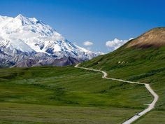 Denali's singular 92-mile (148-kilometer) road leads visitors through its majestic valleys toward the towering Mount McKinley, the crown jewel of the park. On clear days, McKinley can be seen 70 miles (113 kilometers) to the southwest.