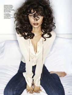 dark brown, curly hair. …