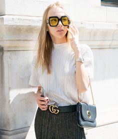 Style Notes: Fashion blogger Oksana Erdogdu combines a metallic Bershka top with Zara trousers—and a couple of Gucci accessories (liek the GG logo belt) for good measure.