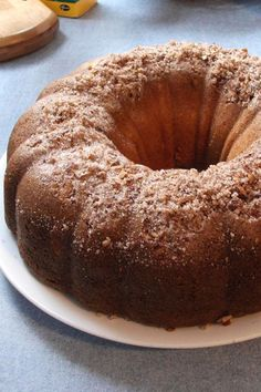 This cream cheese coffee cake is a quick and easy coffee cake recipe! Bake the best coffee cake using cream cheese, lemon juice, sour cream, and cinnamon. You will love baking this coffee cake recipe for dessert, breakfast, and brunch!