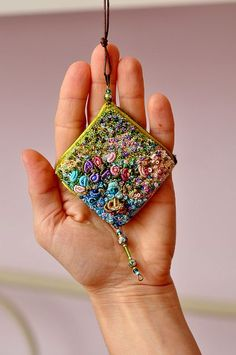 french knot brooch or pendant finished by moligami, via Flickr