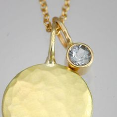 Hammered Disc with Aquamarine Drop by LaineBenthalldesigns on Etsy, $755.00
