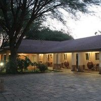 Santai Guest House in Brits, luxury en-suite guest rooms, swimming pool, gym and steam room. Just 15km from Hartbeespoort Dam in lush, tranquil garden setting.