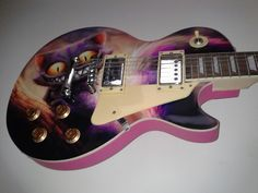 Another happy guitar skin customer.  This one from Ireland with the Alice Cat design.  SkinYourSkunk.com