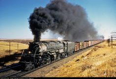 RailPictures.Net Photo: UP 4011 Union Pacific Steam 4-8-8-4. A Big Boy hauls a freight over Sherman Hill with another steam engine on the rear assisting.
