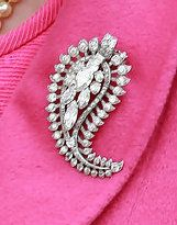 The Queen Mother's Palm Leaf Brooch   One of the Queen Mother's favorite brooches was this palm leaf, created for her by Cartier from ston...