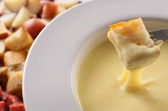 White wine, Emmentaler, and Gruyère melted together into a delicious hot dip.