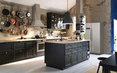 Traditional dark kitchen with solid wood and black worktops plus traditional…