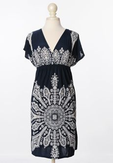 Homecoming Trunk Shows - With a truly classic print, coupled with remarkable tailoring, this dress makes a subtle yet lasting impression.