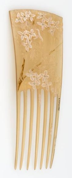 An Art Nouveau hair comb, by Lucien Gaillard, Paris, early 20th century. The tortoiseshell comb carved with floral motifs set with diamonds. Signed L. GAILLARD. #Gaillard #ArtNouveau #comb