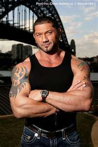 I love him. I wish he'd come back to wrestling. I still watch past matches jus to watch his Batista Bomb and his unreal body ()...I love love love him!!!! Batista