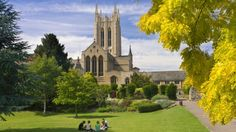 East Anglia idyll: students at the Abbey Gardens with St James cathedral in the background.