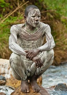 For #PortraitTuesday curated by +Laura Balc. A young man from the Suri tribe in traditional warpaint Omo River Valley, Ethiopia